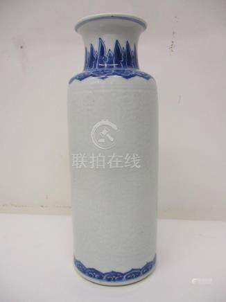 A late 19th century Chinese cylindrical carved, blue and white vase, with a flared neck decorated