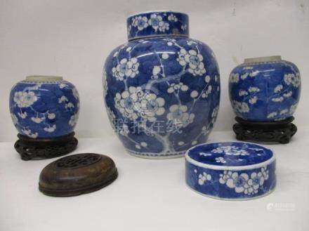 Three late 19th century Chinese Imari prunus pattern blue and white ginger jars, comprising one with