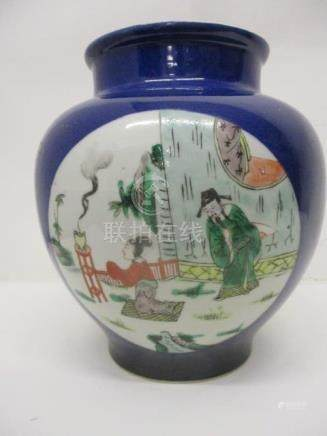 A late 19th century Chinese vase of ovoid form decorated with three panels of figures in garden