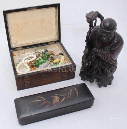 A Chinese carved ebony Happy Buddha, together with a rectangular lacquer work box and a mother of