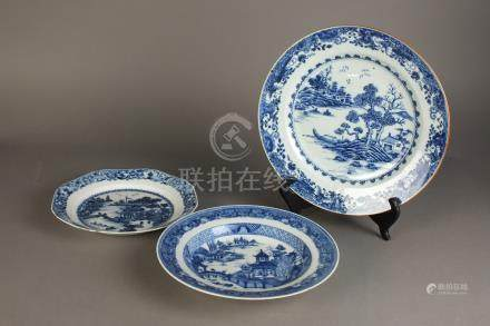 A Chinese blue and white dish Qianlong Of plain circular form and decorated with a riverscape with
