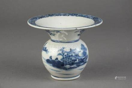 A Chinese blue and white spittoon 18th/19th Century The globular body with wide flared rim,