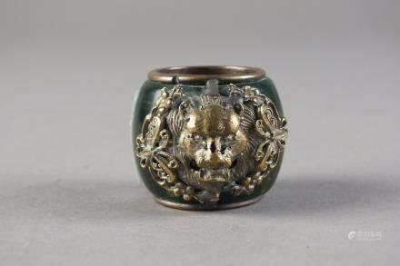 A Sino-Tibetan archer's ring 20th Century The green agate ring around a copper core,