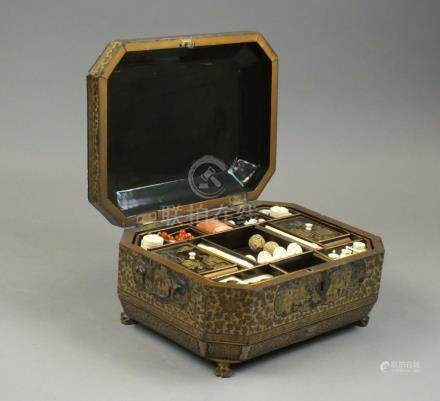 A Chinese export lacquer sewing box 19th Century Of canted rectangular form with hinged ogee cover,