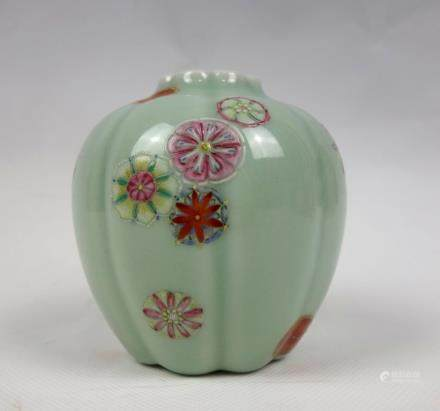 A CELADON GROUND AND FAMILLE ROSE LOBE JAR