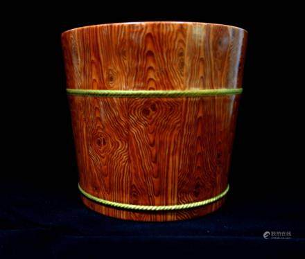 A WOODEN-TYPE WATER BUCKET