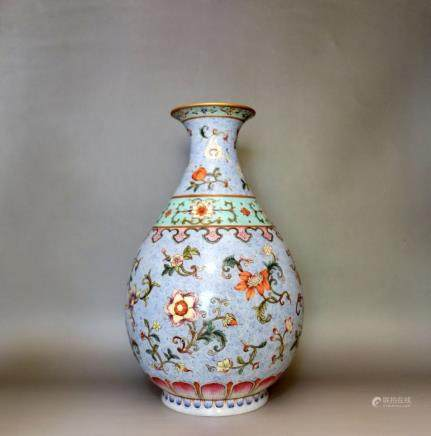A BLUE GROUND AND FAMILLE ROSE YUHUCHUN VASE
