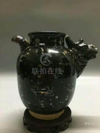 A BLACK-GLAZED JAR