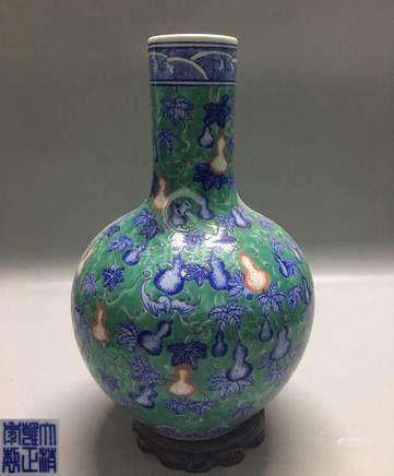 A GREEN-GROUND GOURD PATTERN TIANQIU VASE