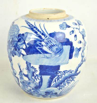 A late 19th century Chinese porcelain ginger jar painted in underglaze blue with bird amongst