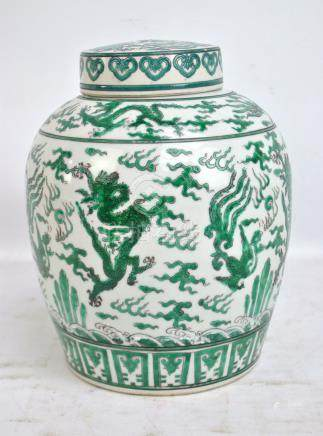 An early 20th century Chinese porcelain ginger jar and cover painted in green enamels with dragons