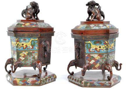 A pair of 19th century Chinese bronze champlevé enamel decorated hexagonal urns with covers,