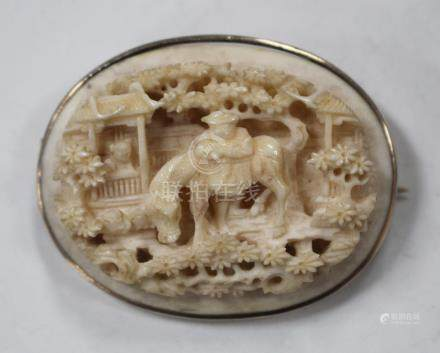 A Chinese Canton export ivory oval plaque, mid-19th century, carved and pierced in relief with a