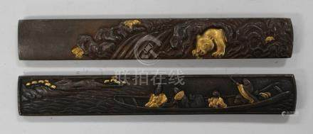 Two Japanese copper kozuka, Meiji period, one handle decorated in relief with figures in a boat, the