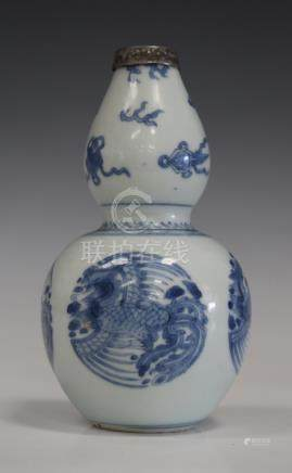 A Chinese blue and white porcelain double gourd vase, mark of Xuande but Kangxi period, the lower