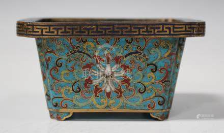 A Chinese cloisonné small jardinière, probably late Qing dynasty, of tapered rectangular form, the