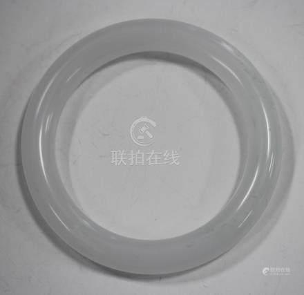 A Chinese white jade bangle, 20th century, outer diameter 7.7cm, inner diameter 5.6cm.Buyer's