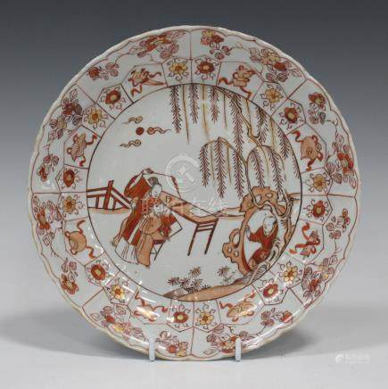 A Chinese porcelain circular dish, Kangxi period, painted in iron red and gilt with a central