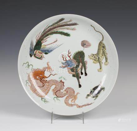 A Chinese famille verte porcelain circular dish, 19th century, the interior painted with a dragon,