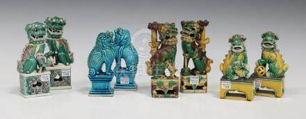A pair of Chinese sancai glazed porcelain Buddhistic lion jostick holders, late 19th century, each