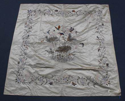 A Chinese cream silk embroidered table cover, early 20th century, worked in coloured threads with