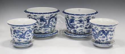 A pair of Chinese blue and white porcelain jardinières and stands, mark of Qianlong but 20th