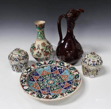 A Turkish Chanakele brown glazed pottery ewer, late 19th century, the globular body and narrow