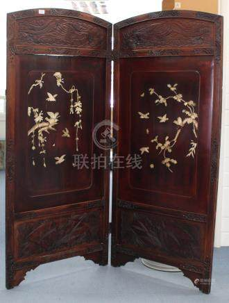 A Japanese inlaid lacquer two-fold screen, Meiji period, each panel inlaid in bone with birds and
