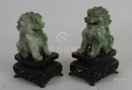 A pair of jade dogs of foe on matched carved wooden stand, 13 cm tall including stand,
