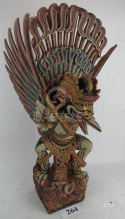 A Tibetan painted wooden model of Garuda, 20th century, 75 cm high,