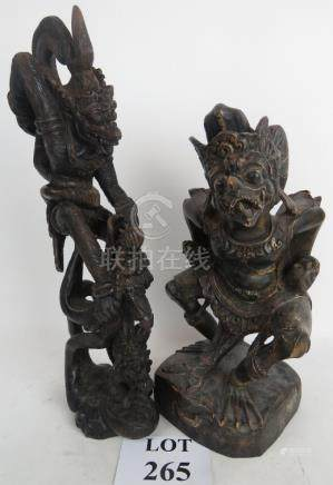 Two Tibetan carved wood models of mythical figures,