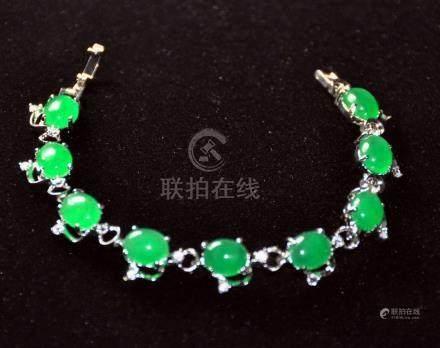 A translucent green jadeite bracelet