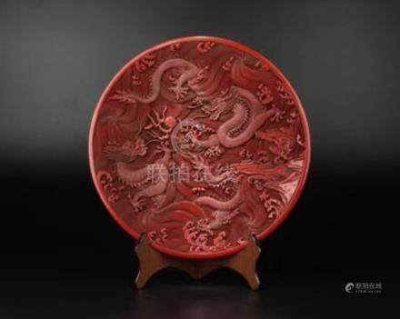 A RED LACQUER DRAGON PATTERN CHARGER
