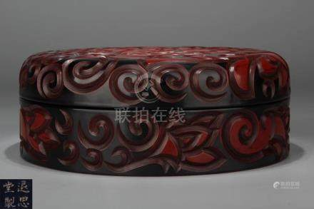 A RED LACQUER FLORAL PATTERN BOX
