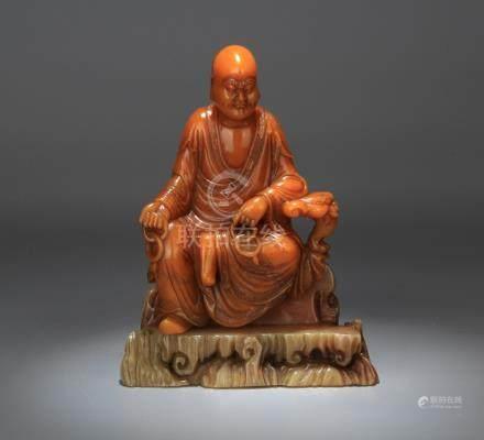 A SOAPSTONE LUOHAN BUDDHA FIGURE