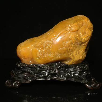 A SOAPSTONE CARVED ORNAMENT