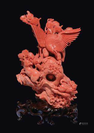 A large carved coral group with wild beast, a deer and an eagle, China, early 20th century