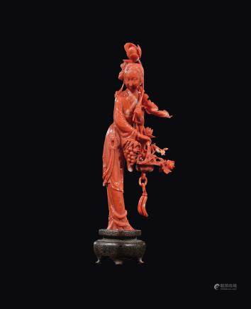 A carved coral figure of Guanyin with grapes and roses, China, early 20th century