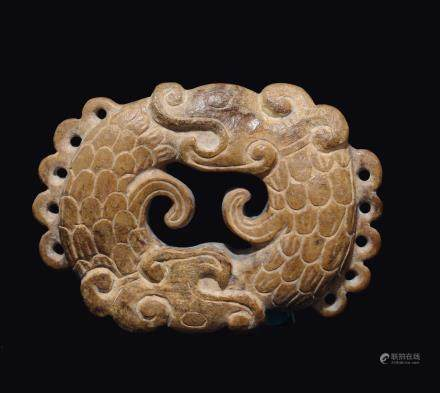 "A yellow jade ""oroboros"" plaque, China, probably Song Dynasty (960-1279)"