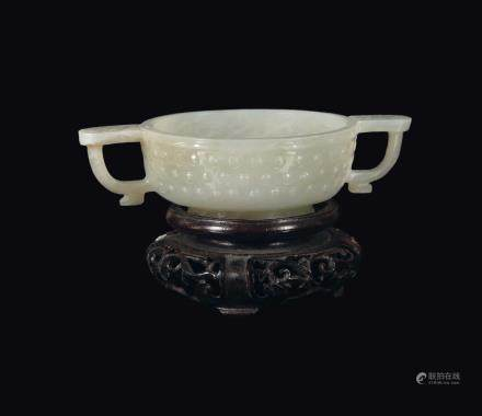 A white jade archaistic two-handled cup with bosses in rilief, China, Qing Dynasty, Qianlong Period (1736-1795)