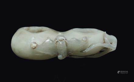 "A white jade ""double fruit and bat"" brush bowl, China, Qing Dynasty, 19th century"