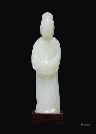 A white jade figure of dignitary, China, Qing Dynasty, 18th century