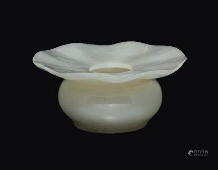 A white jade cup with flower-shaped mouth, China, Qing Dynasty, Qianlong Period (1736-1795)