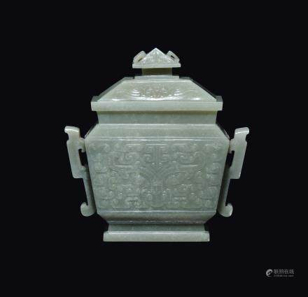 A Celadon white jade vase and cover with a geometric archaic style motif, China, Qing Dynasty, Qianlong Period (1736-1795)