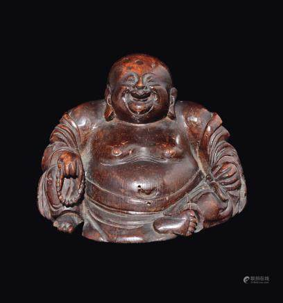A carved wood figure of Budai, China, Qing Dynasty, Kangxi Period (1662-1722)