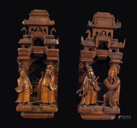 Two carved fruit wood temples with figures, China, Qing Dynasty, 19th century