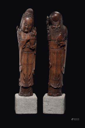 A pair of large carved wood figures, Guanyin and Shoulao, China, Qing Dynasty, late 19th century