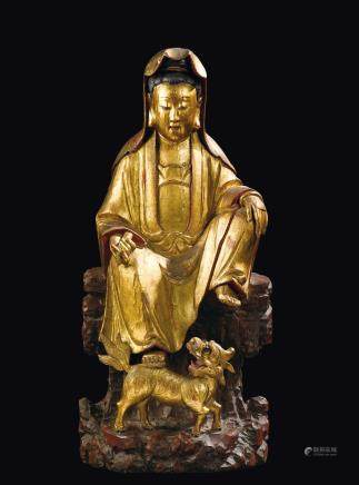 "A gilt and lacquered wood ""sitting Guanyin with scroll and Pho dog"", China, Qing Dynasty, Qianlong Period (1736-1795)"