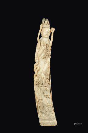 A large carved ivory figure of crowned Guanyin on lotus flower with basket and flowering branches, China, early 20th century