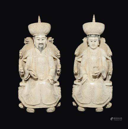 A pair of carved ivory emperors seated on throne, China, Qing Dynasty, 19th century
